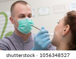 dentist in the office  | Shutterstock . vector #1056348527