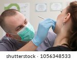 dentist in the office  | Shutterstock . vector #1056348533