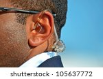 earpiece in a Secret Service agent's ear - stock photo