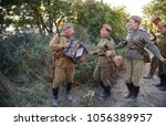 Small photo of Sevastopol, Crimea, RUSSIA - SEPTEMBER 16, 2017: Military-historical festival in Crimea. Battle for Sevastopol, Soviet soldier with accordion sings songs