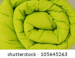 Rolled up duvet. Close up. - stock photo