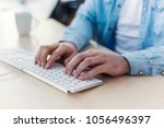 hands typing on keyboard at the ... | Shutterstock . vector #1056496397