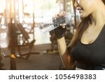 cropped shot woman drinking...   Shutterstock . vector #1056498383