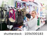 young woman seller 20 29 years... | Shutterstock . vector #1056500183