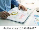 Small photo of internal audit concept - man with magnifying glass inspecting business documents