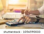 businessman accountant using... | Shutterstock . vector #1056590033
