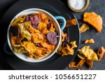 mixed fried vegetable chips in... | Shutterstock . vector #1056651227