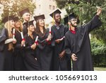 a group of multietnic students... | Shutterstock . vector #1056691013