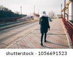 full length rear view of a... | Shutterstock . vector #1056691523