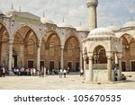 ISTANBUL, TURKEY - JUNE 03: Tourists in the courtyard of Sultanahmet Mosque on June 03, 2012 in Istanbul, Turkey. This is the biggest mosque in Istanbul of Sultan Ahmed is a great tourist attraction. - stock photo