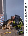 firefighter plays with a... | Shutterstock . vector #1056705713