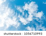 nice blue sky with white clouds. | Shutterstock . vector #1056710993