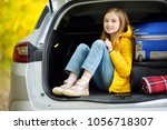 adorable girl with a suitcase... | Shutterstock . vector #1056718307