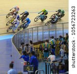 Small photo of Malaysia, 16th - 20th February 2018: athlete taking last corner during 38th Asian Track Cycling Championship at National Velodrome in Nilai.