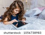 cute little girl with curly... | Shutterstock . vector #1056738983