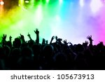 cheering crowd in front of colorful stage lights - stock photo