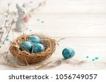 easter background with easter... | Shutterstock . vector #1056749057