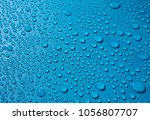 water drops on blue background... | Shutterstock . vector #1056807707