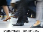 motion blurred of people... | Shutterstock . vector #1056840557