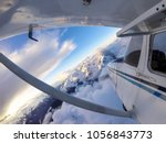 small airplane flying over the... | Shutterstock . vector #1056843773