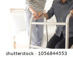 walk training   stroke patient... | Shutterstock . vector #1056844553