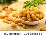 dried raisins  delicious dry... | Shutterstock . vector #1056846563