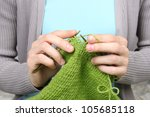 woman knitting green threads closeup - stock photo