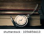 old book and clock close up... | Shutterstock . vector #1056856613