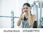 depressed young asian... | Shutterstock . vector #1056887993