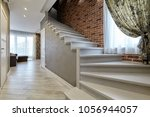 ladder with wooden handrails | Shutterstock . vector #1056944057