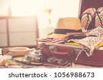 travel suitcase prepareing... | Shutterstock . vector #1056988673