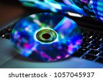 dvd disc isolated on computer... | Shutterstock . vector #1057045937