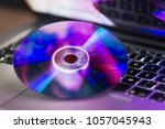 dvd disc isolated on computer... | Shutterstock . vector #1057045943