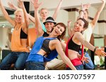 young people dancing in a... | Shutterstock . vector #105707597