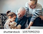 grandparents playing with their ... | Shutterstock . vector #1057090253