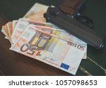 lot of euro banknotes and gun...   Shutterstock . vector #1057098653