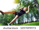 kid bungee jumping in the...   Shutterstock . vector #1057099973