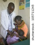 JANUARY 2007 - A doctor checks mother and children for HIV/AIDS at Pepo La Tumaini Jangwani, HIV/AIDS Community Rehabilitation Program, Orphanage & Clinic. Nairobi, Kenya, Africa - stock photo