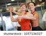 dance teacher showing senior...   Shutterstock . vector #1057136327