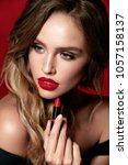 beauty makeup. woman with red... | Shutterstock . vector #1057158137