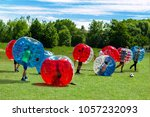 children playing  in bubble... | Shutterstock . vector #1057232093