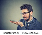 hipster man in glasses using a... | Shutterstock . vector #1057326563