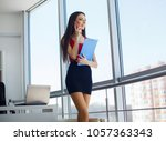 young professional woman with...   Shutterstock . vector #1057363343