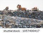 dump trucks unloading waste... | Shutterstock . vector #1057400417