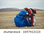 skydiver collects a parachute... | Shutterstock . vector #1057412123