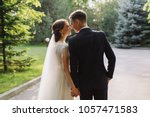 bride and groom in a park... | Shutterstock . vector #1057471583