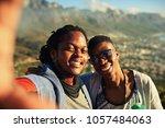 two happy male african friends... | Shutterstock . vector #1057484063