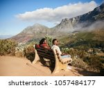 two black guys sitting together ... | Shutterstock . vector #1057484177