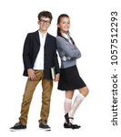 two kids wearing formal clothes ... | Shutterstock . vector #1057512293