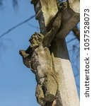 jesus christ on stone crucifix... | Shutterstock . vector #1057528073
